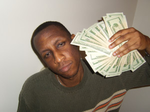 image of a man with a wad of cash